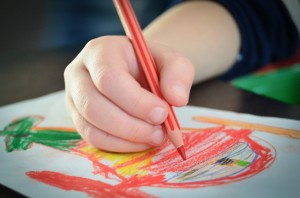 Child hand coloring